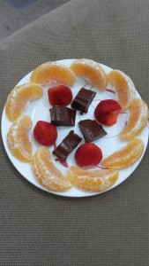 Chocolate peanut butter fudge, strawberries, and orange slices